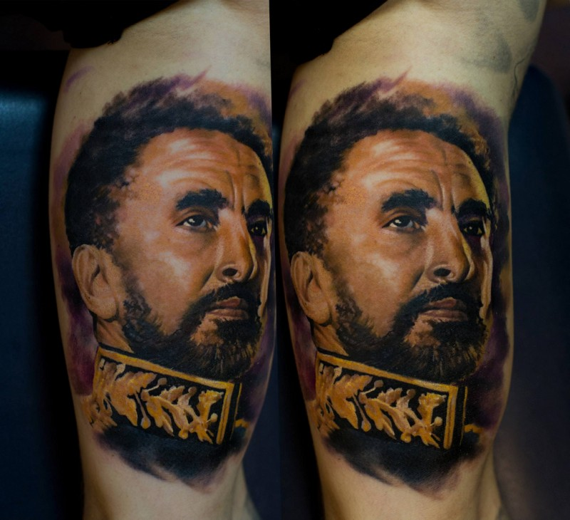 Portrait style colored biceps tattoo of military man face