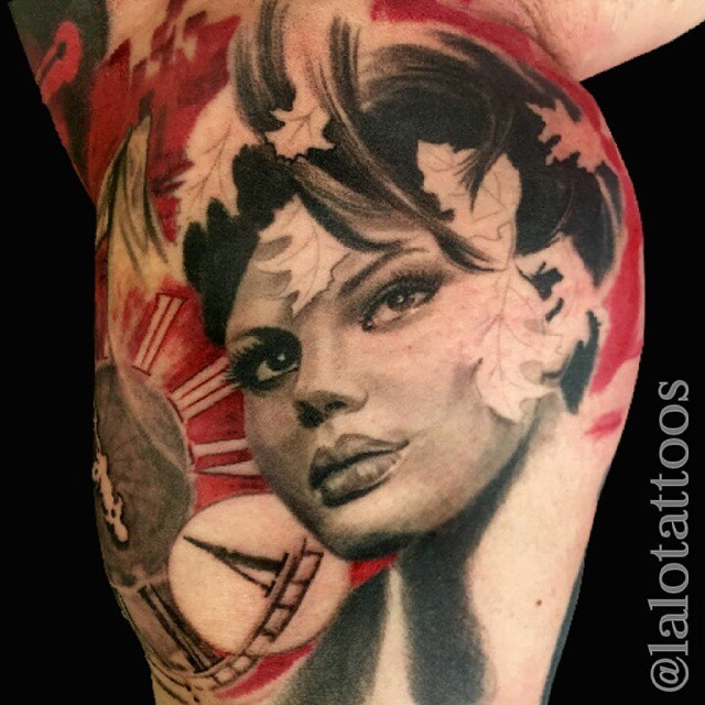 Portrait style colored biceps tattoo of nice woman face with clock and leaves