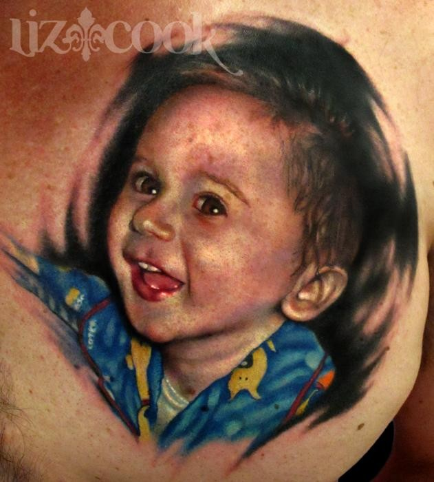 Portrait style colored chest tattoo of smiling boy
