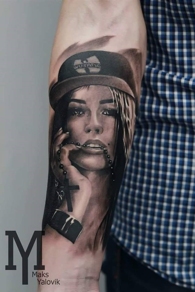 Portrait style colored forearm tattoo of seductive woman with hat