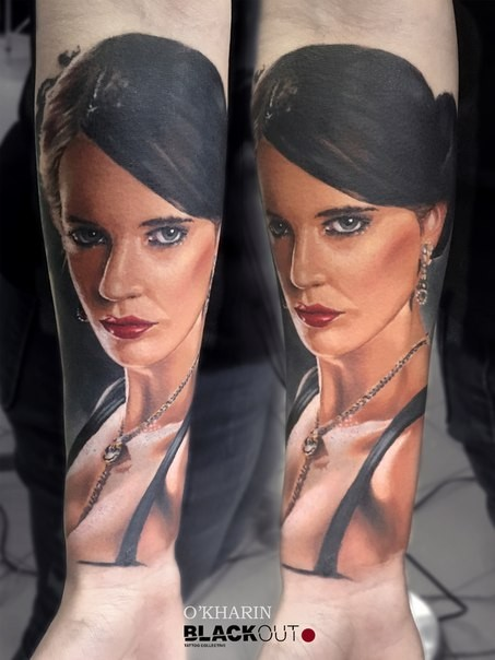 Portrait style colored forearm tattoo of beautiful woman face