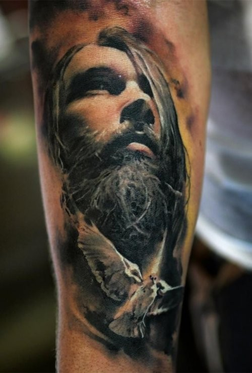 Portrait style colored forearm tattoo of man with beard face