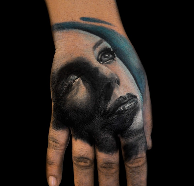 Portrait style colored hand tattoo of beautiful woman portrait