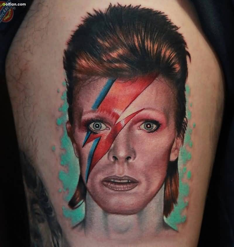 Portrait style colored interesting woman face tattoo on thigh