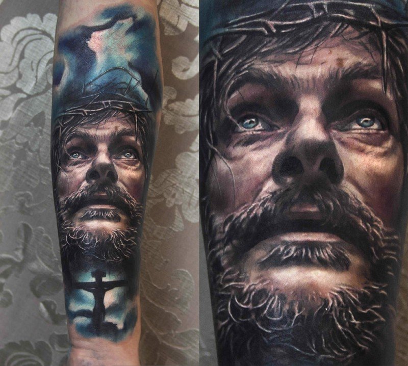 Portrait style colored Jesus face tattoo with dark sky and cross
