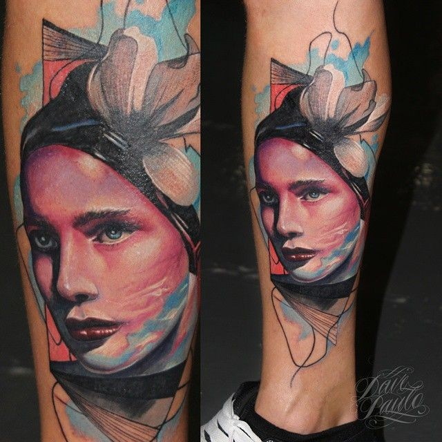 Portrait style colored leg tattoo of beautiful woman face with flower