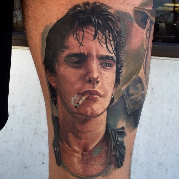 Portrait style colored leg tattoo of smoking man face