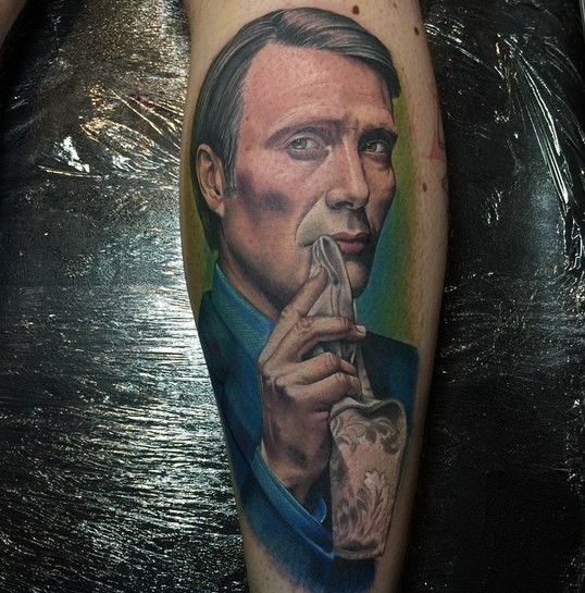 Portrait style colored leg tattoo of famous actor