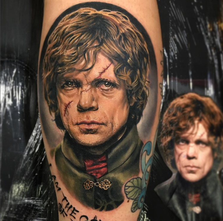 Portrait style colored leg tattoo of Game of Thrones hero face
