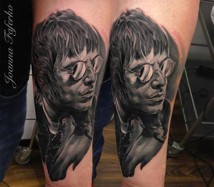 Portrait style colored leg tattoo of man face with glasses