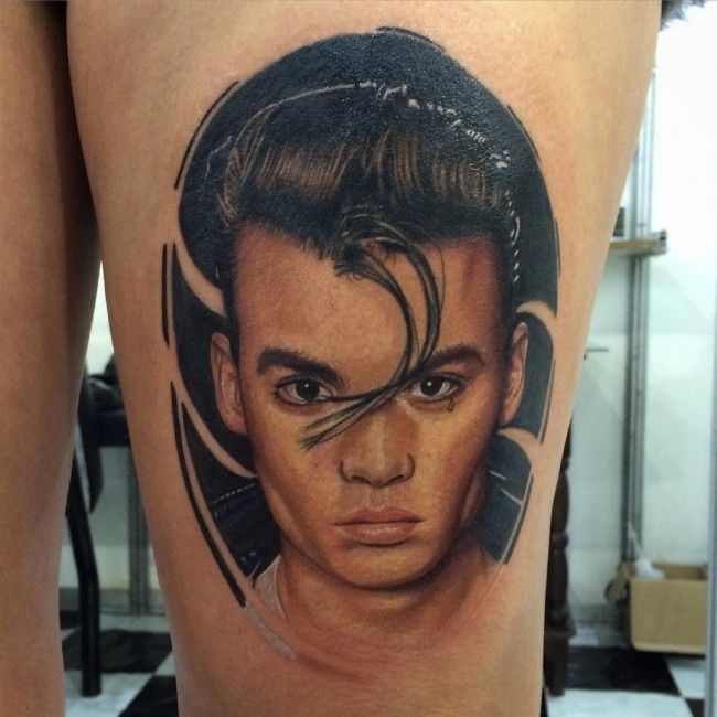 Portrait style colored man portrait tattoo on thigh