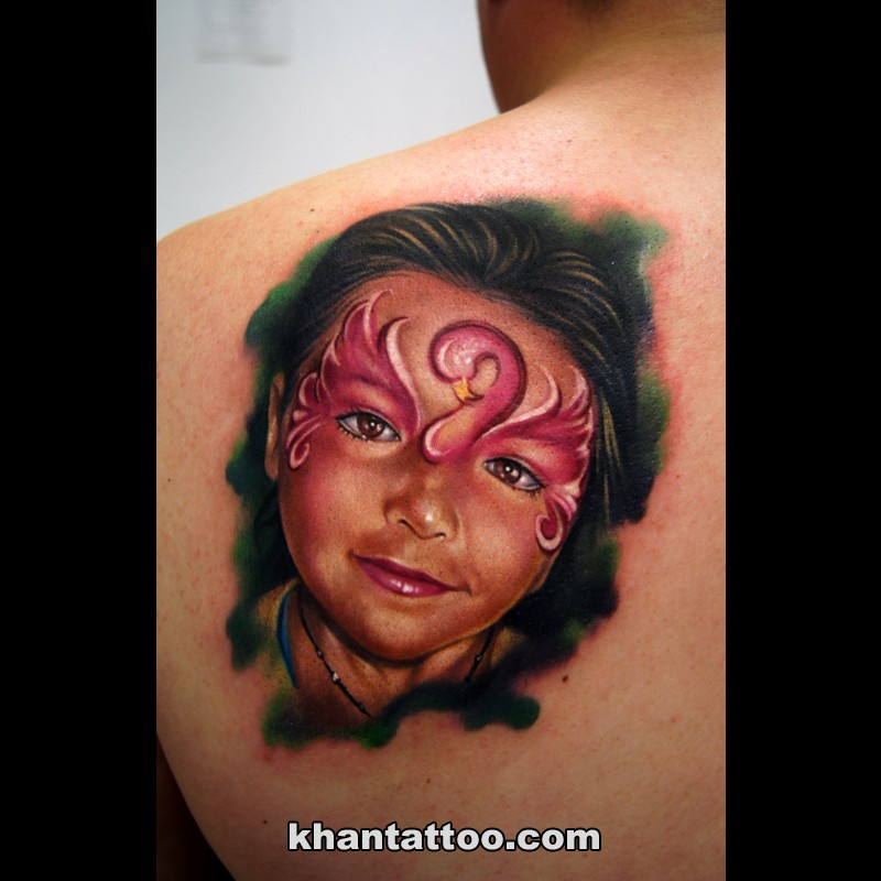 Portrait style colored scapular tattoo of little girl face with makeup