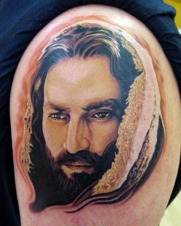 Portrait style colored shoulder tattoo of Jesus portrait