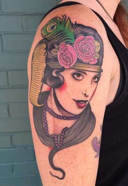 Portrait style colored shoulder tattoo of vintage portrait with flowers