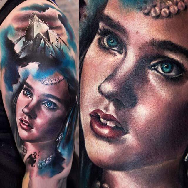 Portrait style colored shoulder tattoo of woman portrait with big castle