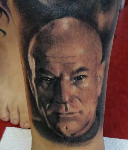Portrait style colored shoulder tattoo of professor Xavier portrait