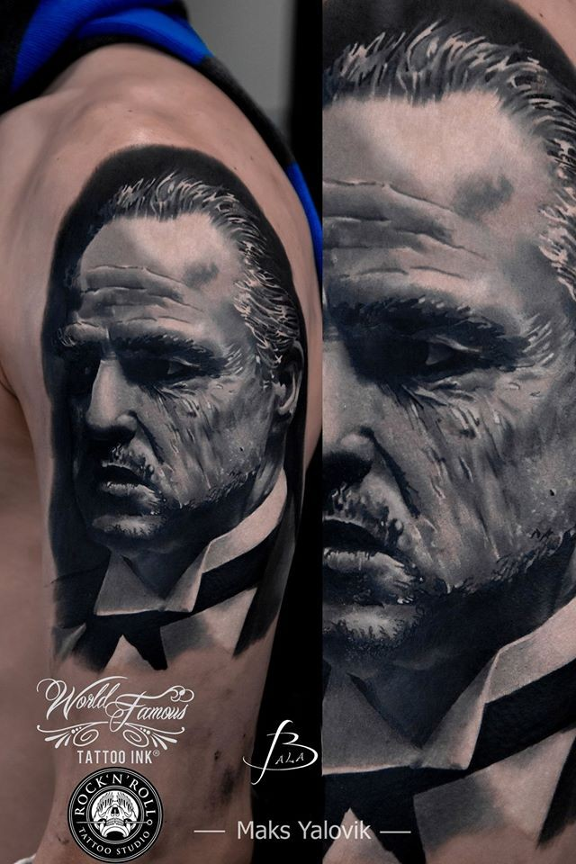 Portrait style colored shoulder tattoo of God Father