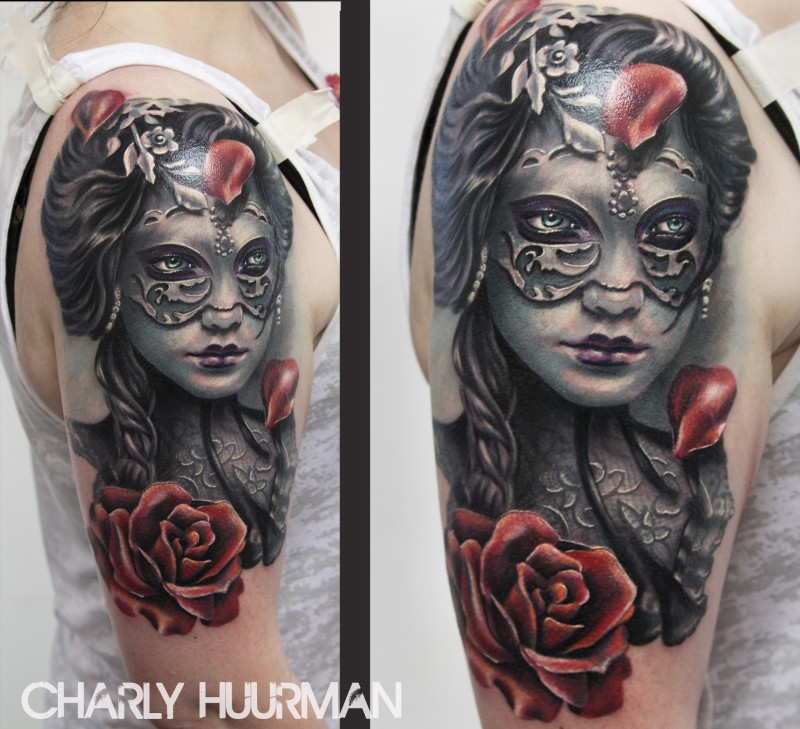 Portrait style colored shoulder tattoo of beautiful woman in mask with flowers