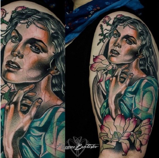 Portrait style colored shoulder tattoo of beautiful woman with flowers