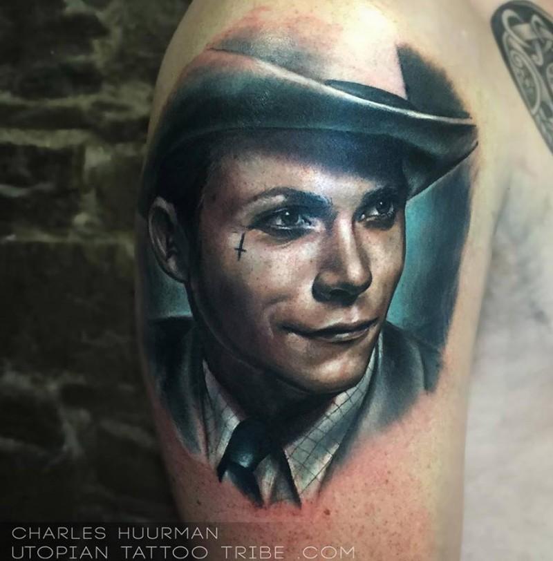 Portrait style colored shoulder tattoo of vintage man face