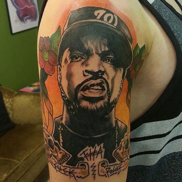 Portrait style colored shoulder tattoo of famous American singer face and lettering
