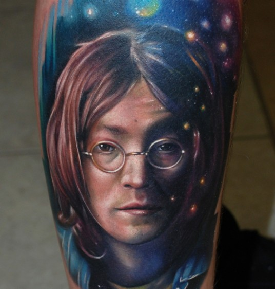 Portrait style colored tattoo of Aron Lennon face