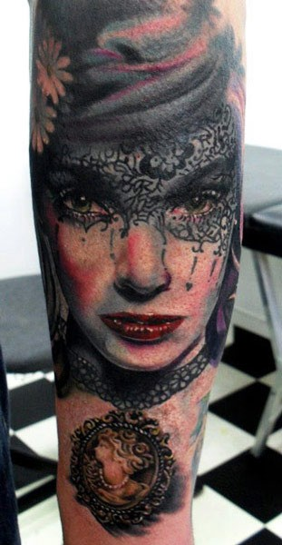 Portrait style colored tattoo of woman with mask and flowers