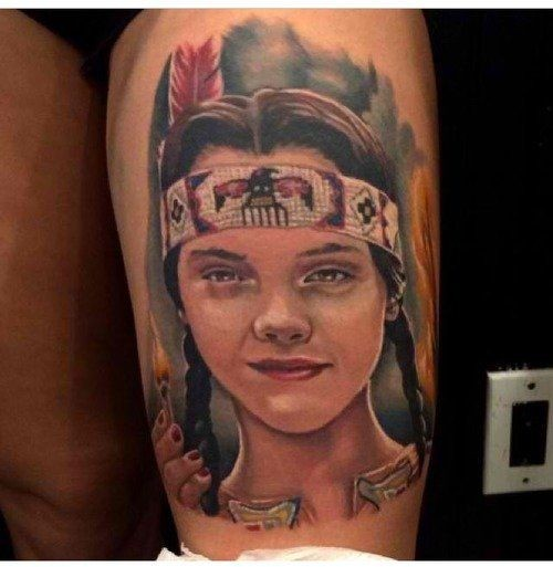 Portrait style colored thigh tattoo of Indian girl face