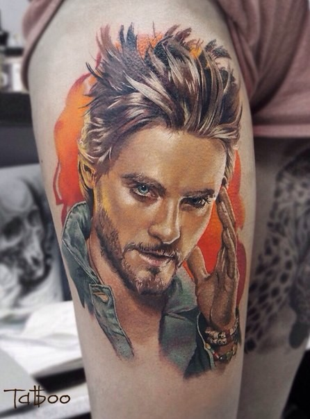 Portrait style colored thigh tattoo of realistic man portrait