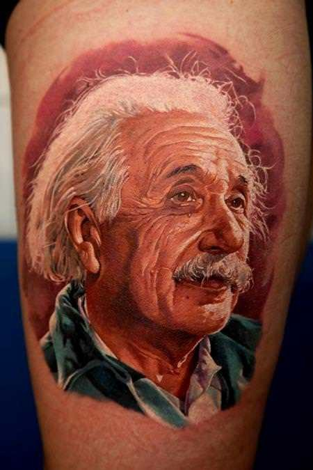 Portrait style colored thigh tattoo of Albert Einstein portrait