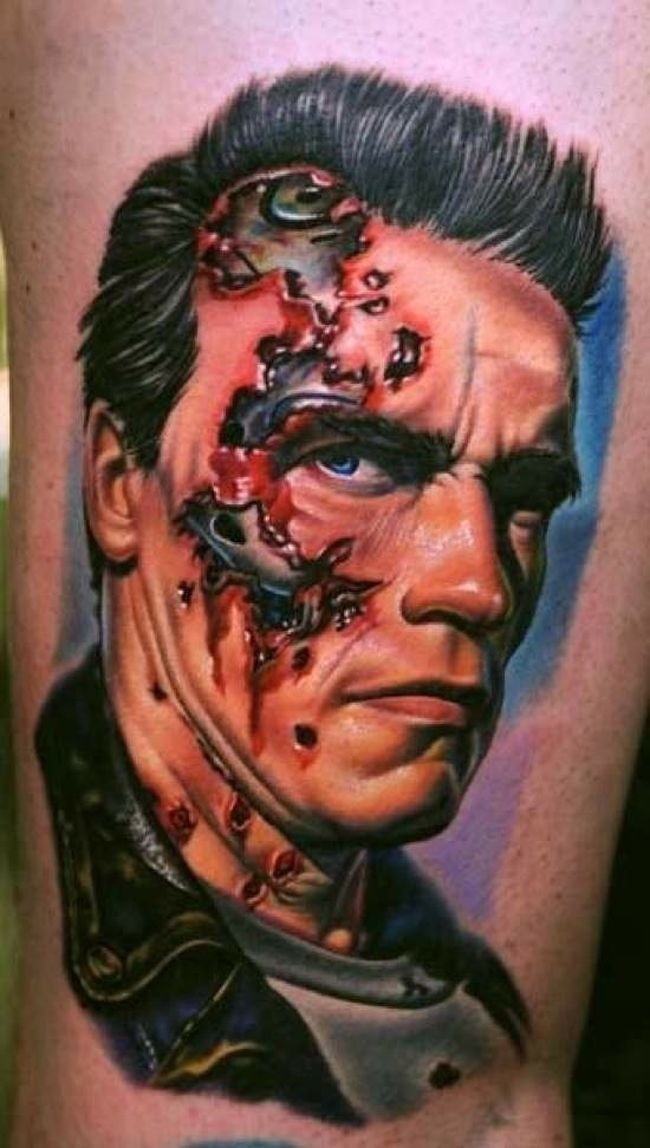 Portrait style colored thigh tattoo of Terminator face