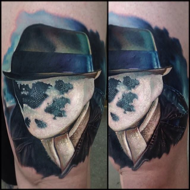 Portrait style colored thigh tattoo of Rorschach portrait