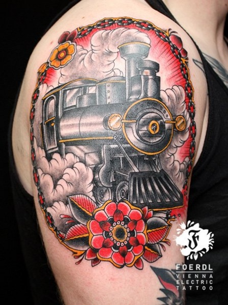 Portrait style colored upper arm tattoo of steam train with large rose