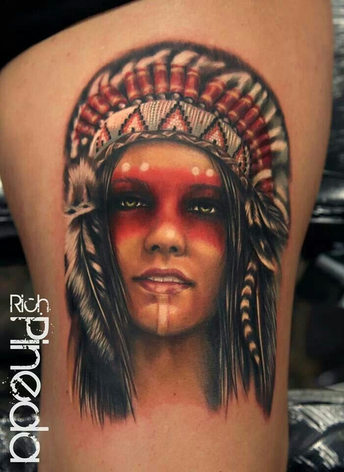 Portrait style colroed thigh tattoo of Indian woman with feather helmet