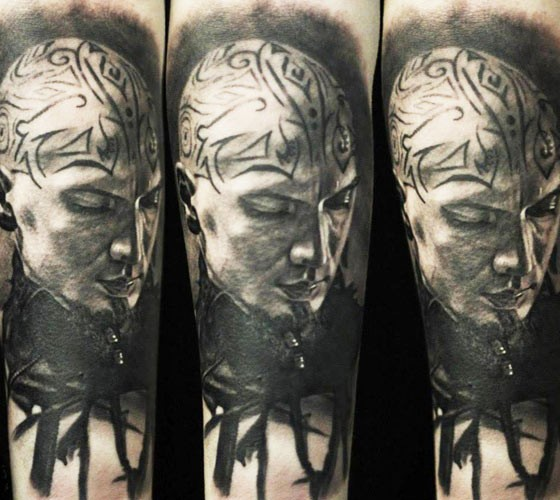 Portrait style detailed arm tattoo of barbarian face