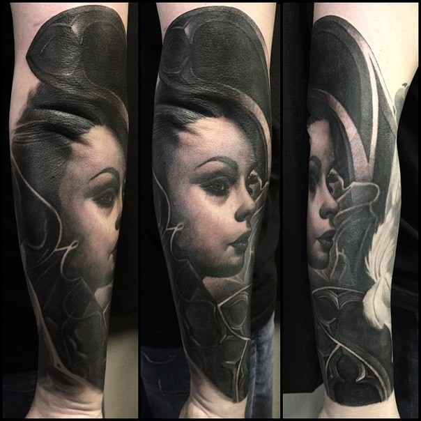 Portrait style detailed forearm tattoo of Asian geisha