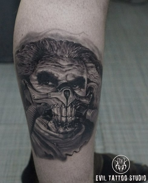 Portrait style detailed leg tattoo of Mad Max evil Boss