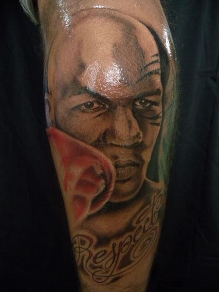 Portrait style detailed looking colored Mike Tyson face tattoo combined with lettering
