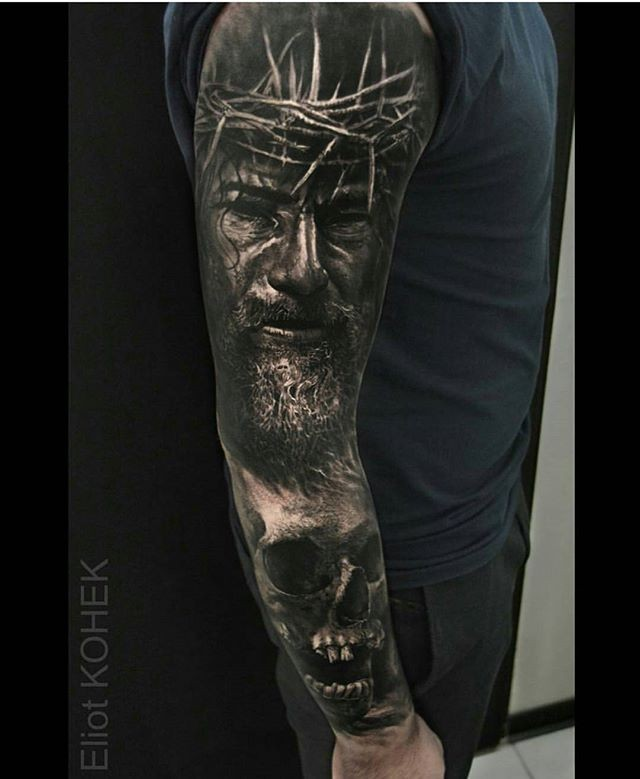 Portrait style large sleeve tattoo of Jesus portrait with human skull