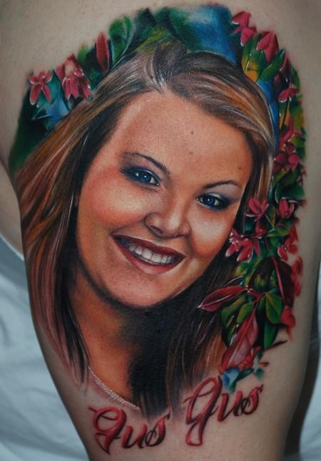 Portrait style very beautiful looking shoulder tattoo smiling woman with flowers