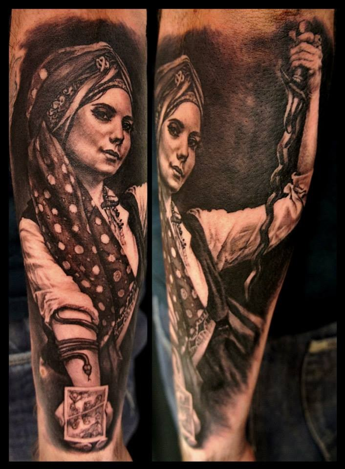 Portrait style very detailed arm tattoo of gypsy woman with snake