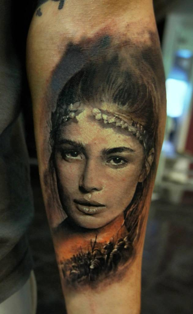 Portrait style very detailed arm tattoo of beautiful ancient woman with warriors