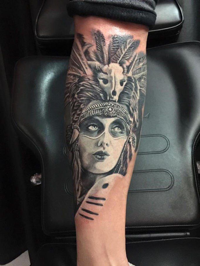 Portrait style very detailed forearm tattoo of Aztec woman face