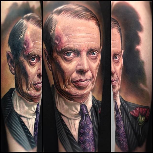 Portrait style very detailed tattoo of cool famous actor in suit and with flower