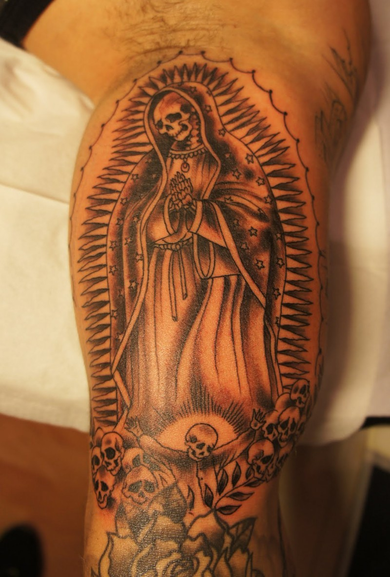 Praying death tattoo on leg