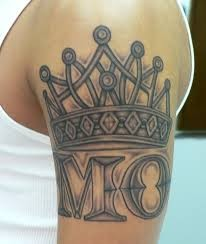 Pretty crown tattoo on shoulder