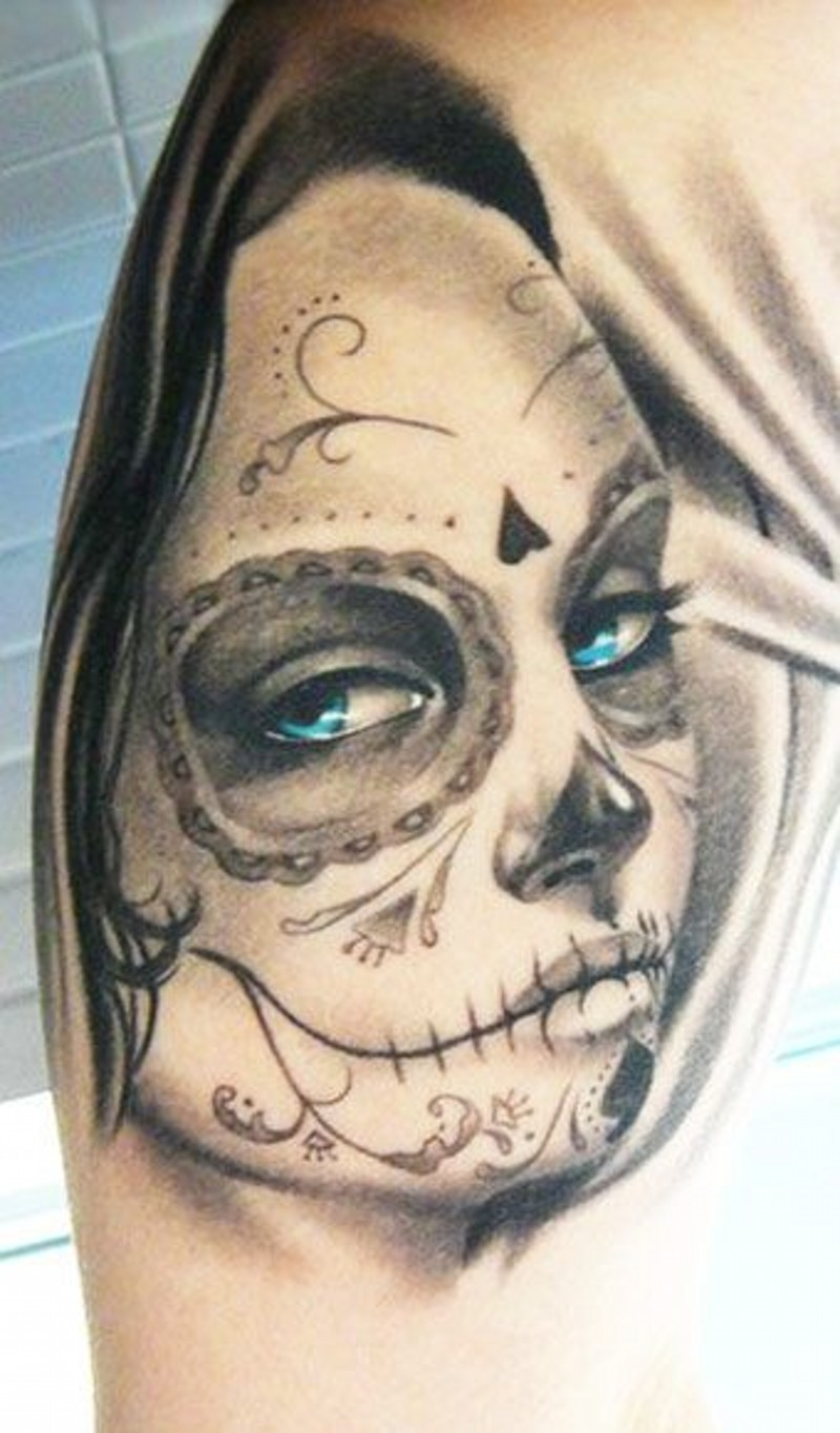 Pretty gray ink day of the dead girl with blue eyes tattoo on shoulder