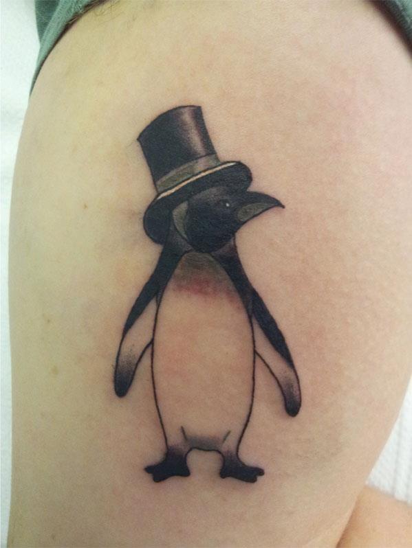 Pretty little penguin tattoo in hat