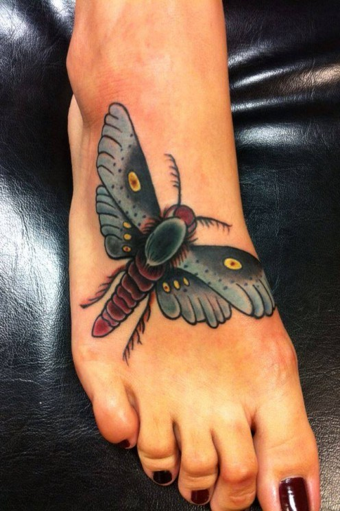 Pretty moth tattoo on foot for lady