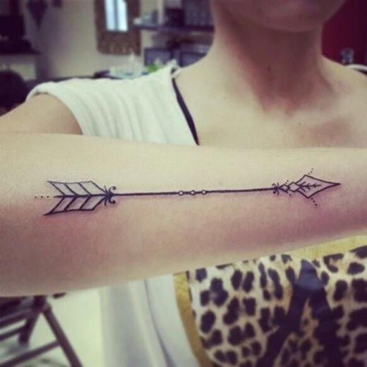 Pretty stylized indian arrow tattoo for girls